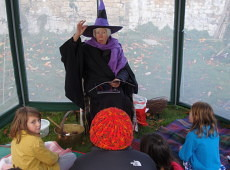 A witch tells spooky stories at Jesmond Orchard's family Halloween. Photo by Charlotte Sylvester.