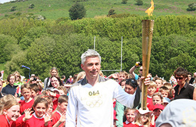 Jonathan Edwards with Olympic Torch