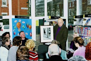 Michael Chaplin shows the audience an old photo of the library