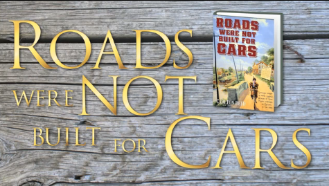 Front cover of 'Roads Were Not Built For Cars'